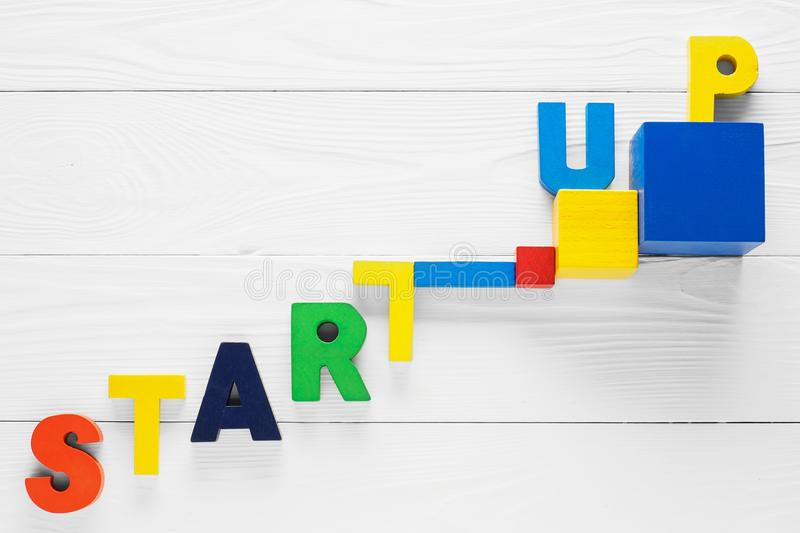 Startup word made from colored wooden letters royalty free stock image