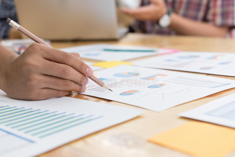 startup young successful team on meeting in modern office interior brainstorming, make a business plan, working on laptop compute royalty free stock images