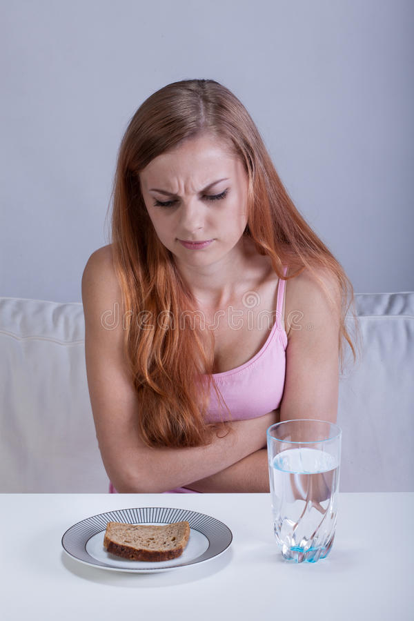 Free Starving Girl Before Breakfast Stock Image - 43052981