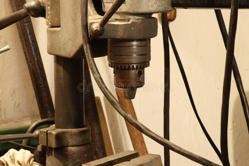 Stary żelazny borer wciąż używa dla musztrować zdjęcia stock