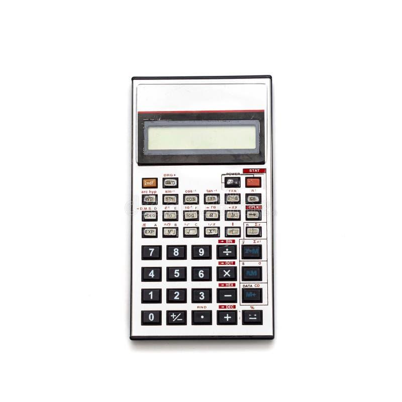Stary aluminiowy kalkulator Odizolowywa obrazy stock
