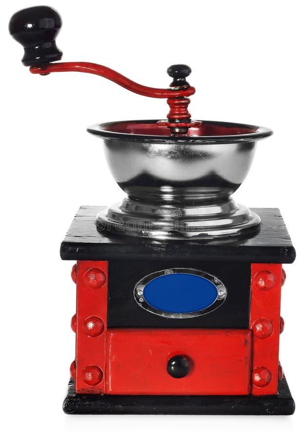Stary antykwarski drewniany czarny i czerwony kawowy ostrzarz fotografia royalty free