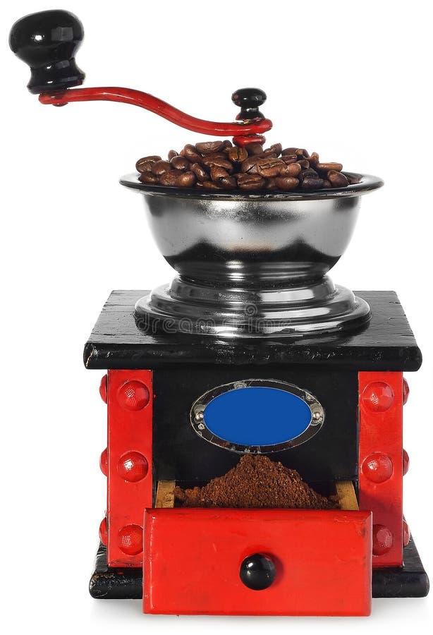 Stary antykwarski drewniany czarny i czerwony kawowy ostrzarz, kawowe fasole obraz royalty free