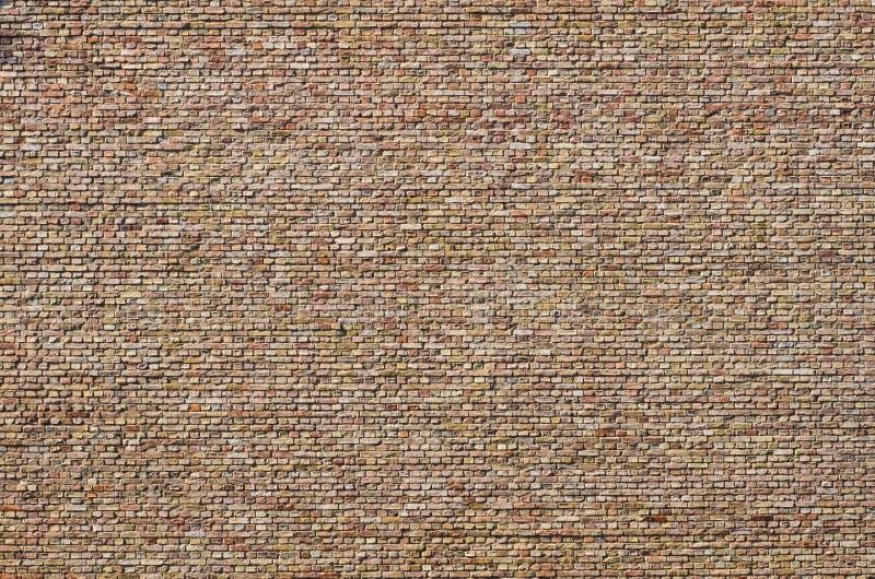 Stary ceglany kamiennej ściany tło - rocznik cegły zdjęcia royalty free