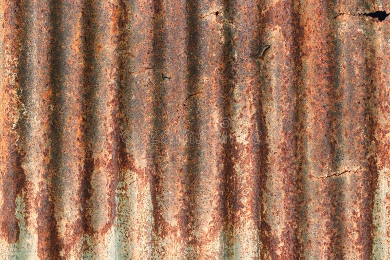 Stary cynk ściany tekstury tło, ośniedziały na galwanizuję metalu panelu ciąć na arkusze fotografia royalty free
