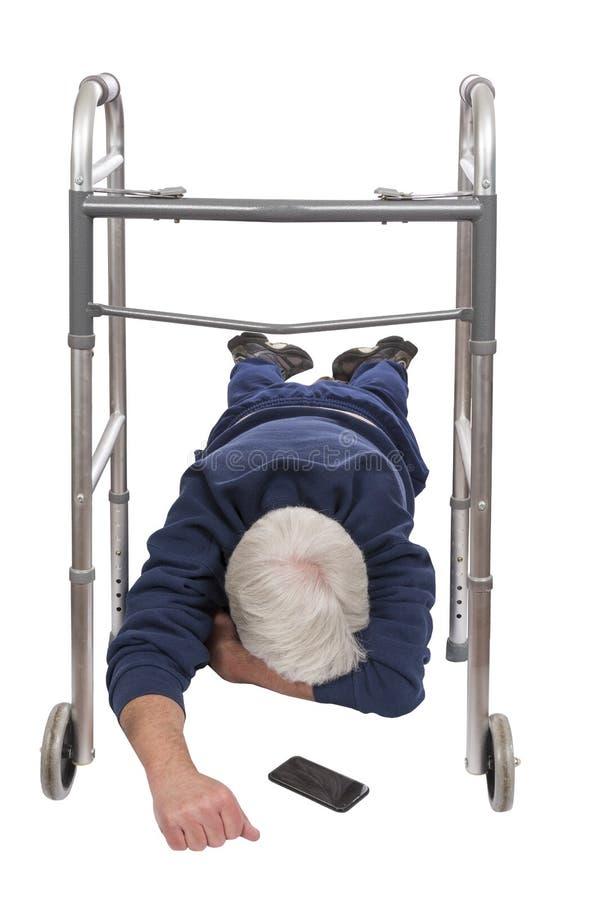 Stary Człowiek Spadać Od Jego piechura Odizolowywającego Na bielu fotografia stock