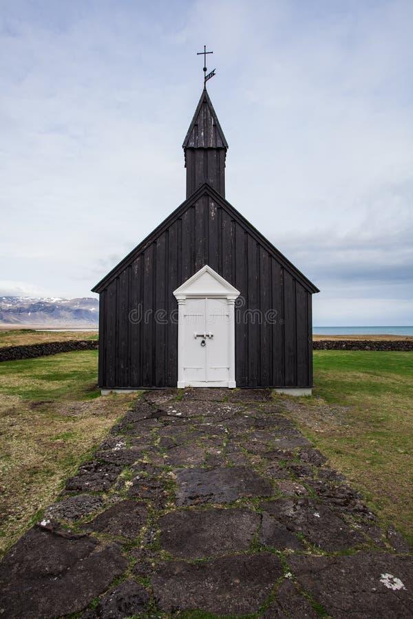 Stary czarny kościół w Iceland zdjęcia royalty free