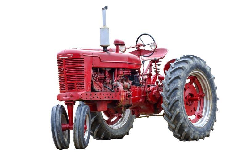Stary Czerwony praca ciągnik Odizolowywający Na bielu zdjęcie royalty free