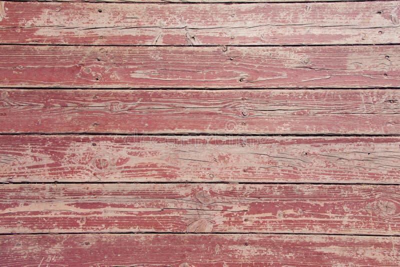 Stary drewniany czerwony podłogowy tekstury zbliżenie Horyzontalni paski z obieranie gwoździami i farbą zdjęcia royalty free