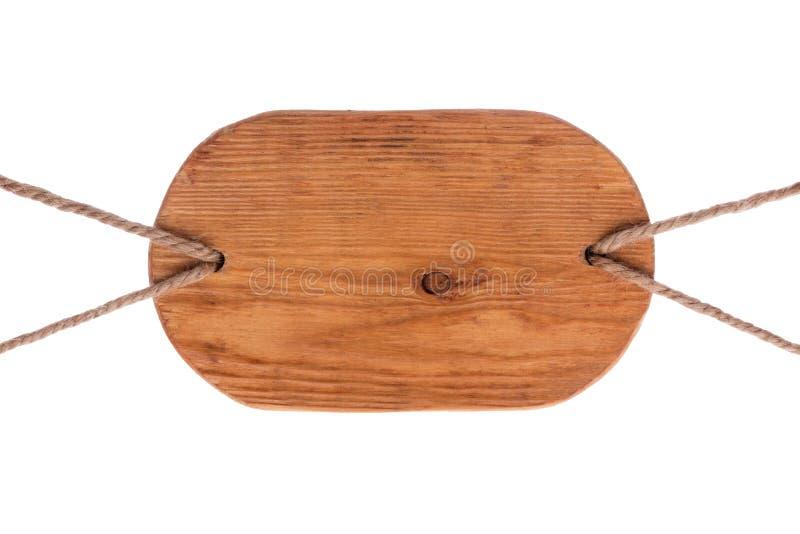 Stary drewniany signboard lekki drewno, wiesza na arkanach odosobniony fotografia royalty free