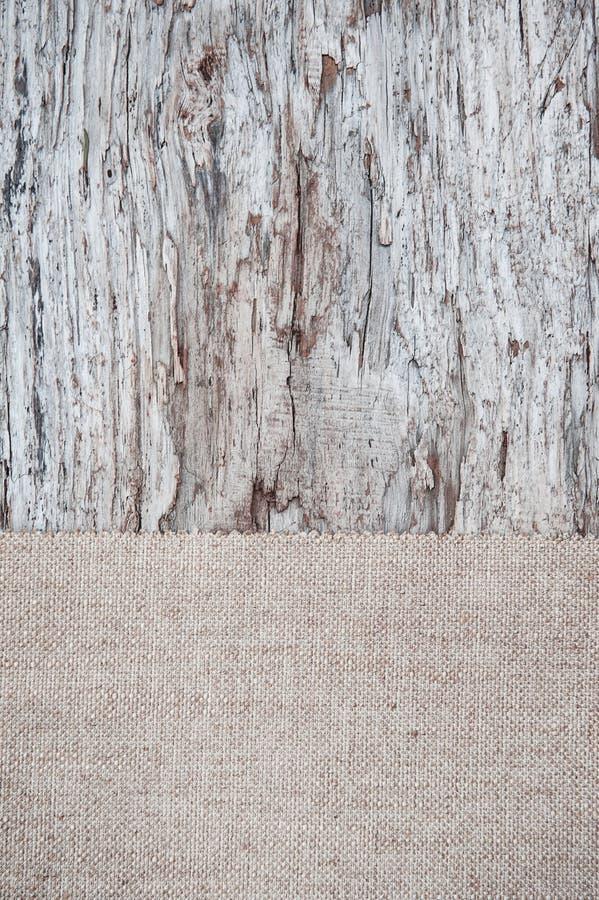 Stary drewniany tło z burlap jutową kanwą zdjęcia royalty free