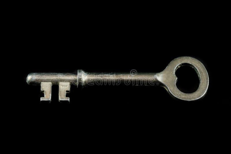 Stary drzwi klucz na czarnym tle obraz royalty free