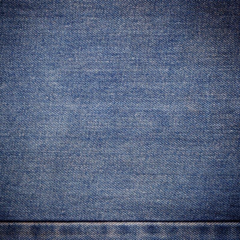 Stary niebiescy dżinsy tło, tekstura i zdjęcie royalty free