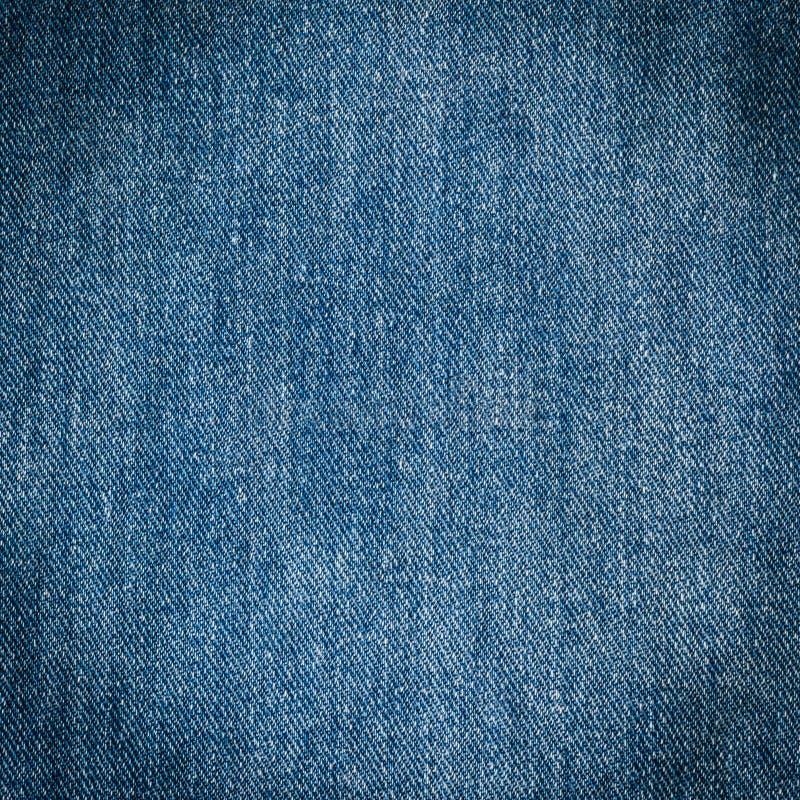 Stary niebiescy dżinsy tło, tekstura i fotografia stock