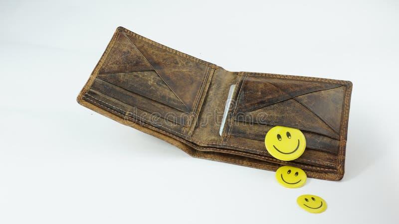 Stary otwarty Rzemienny portfel z szczęśliwymi smiley twarzami odizolowywać na białym tle fotografia royalty free