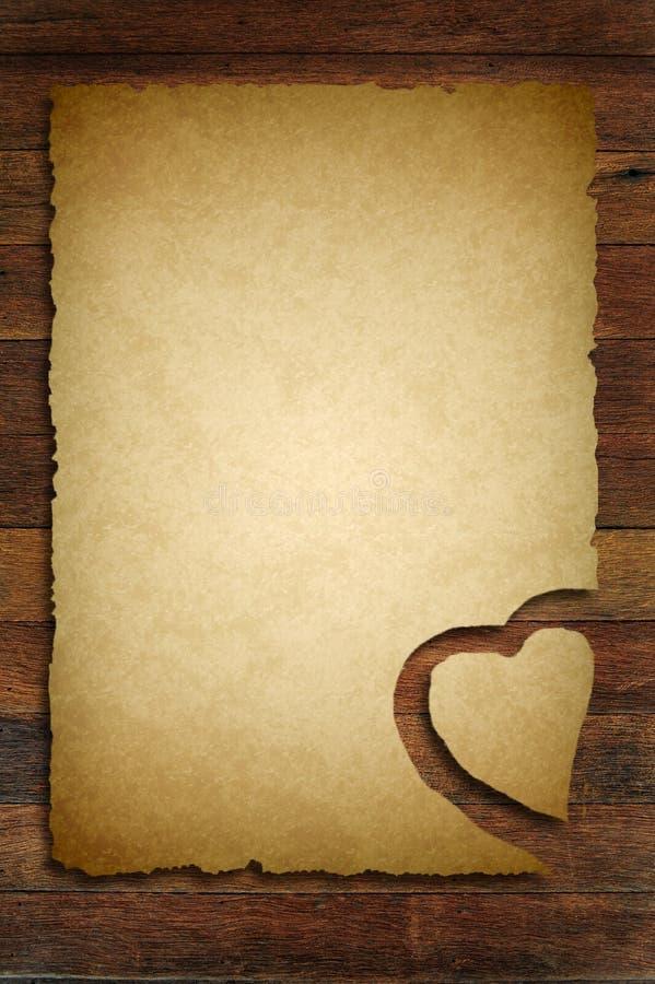 Stary papier z drewnianym serce znakiem royalty ilustracja