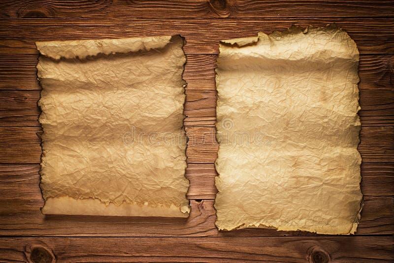 Stary papierowy manuskrypt na biurku, rocznika tło dla teksta obraz royalty free