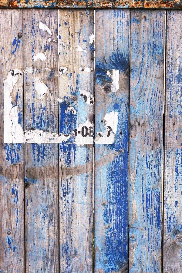 Stary podławy drewniany płotowy tło z śladem reklamy zdjęcie stock