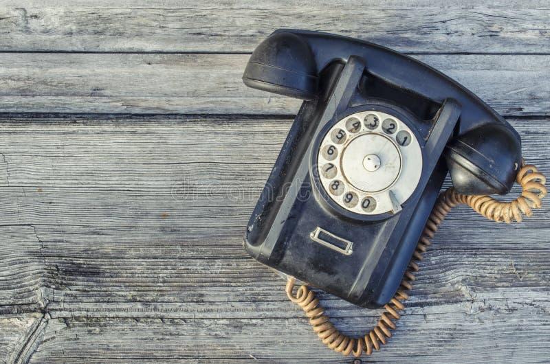 Stary powyginany czerń telefon zdjęcie royalty free