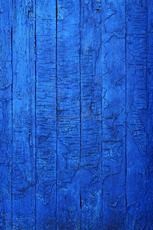 Stary rocznik być ubranym deski malowali w błękitnej farbie obrazy royalty free