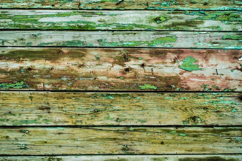Stary tło, pękająca powierzchnia, farba z narysami, moczy malować deski i drewno obrazy stock