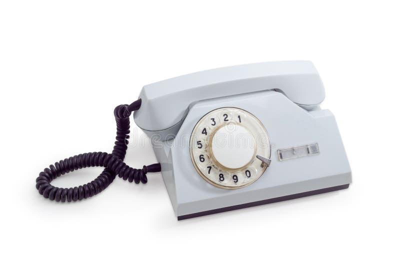Stary telefon ustawia z obrotową tarczą w białym plastikowym budynek mieszkalny fotografia royalty free