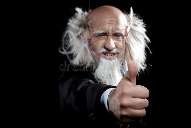 Starych człowieków przedstawień gest klasa w studiu zdjęcia royalty free