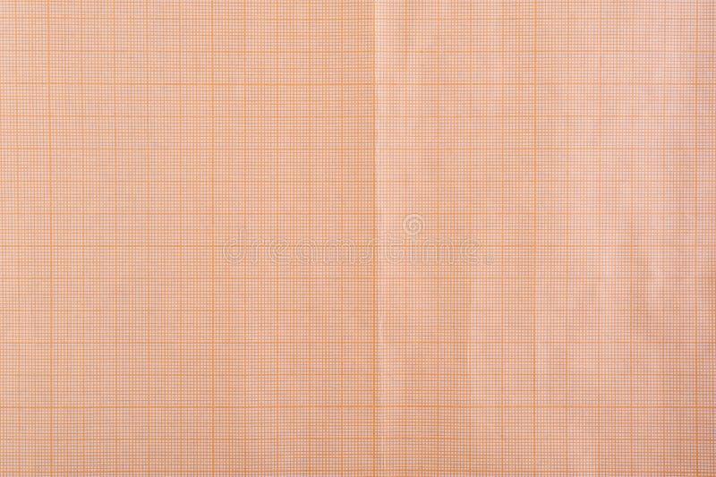 Starzejący się stary grunge siatki milimetru papieru tło Zamyka w górę pomarańczowej sepiowej wykresu papieru tekstury obrazy stock