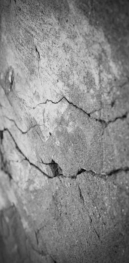 Starzejąca się grunge abstrakta betonu tekstura z wklęśnięciami i pękającym wal obrazy stock