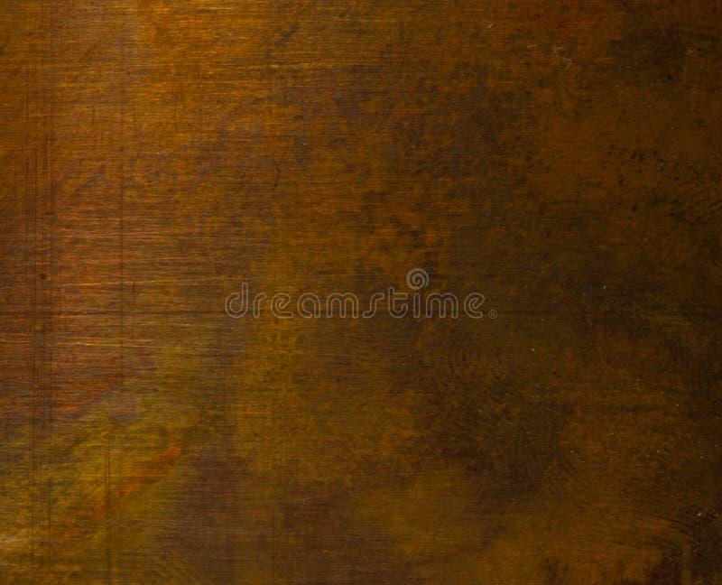 Starzejąca się miedzianego talerza tekstura, stary będący ubranym metalu tło obrazy stock