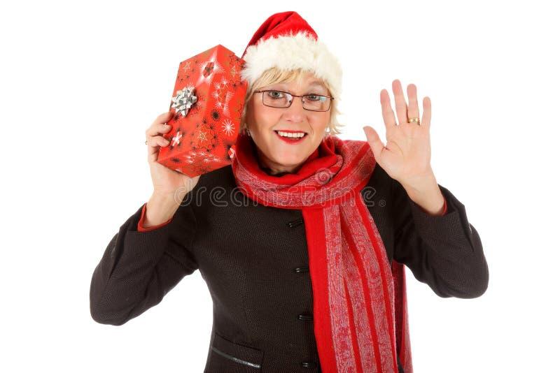 starzejąca się rozochoconego prezenta środkowa Santa kobieta fotografia royalty free