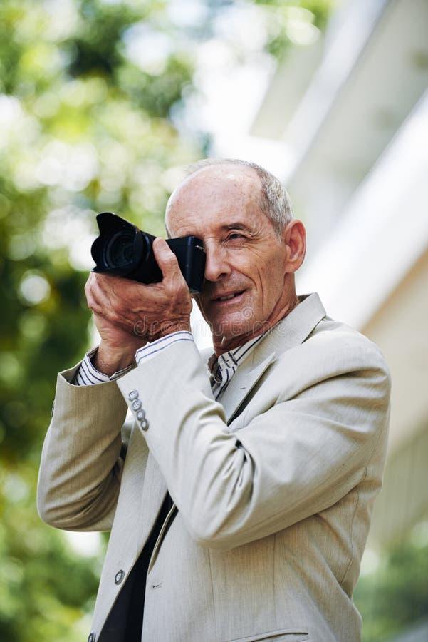 Starzejący się fotograf obraz royalty free