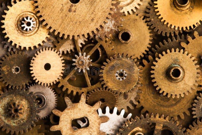 Starzejący się przekładni cogwheels tło Retro machinalny zegarowy akcesoria zakończenie Płytka głębia pole, miękka ostrość zdjęcia royalty free