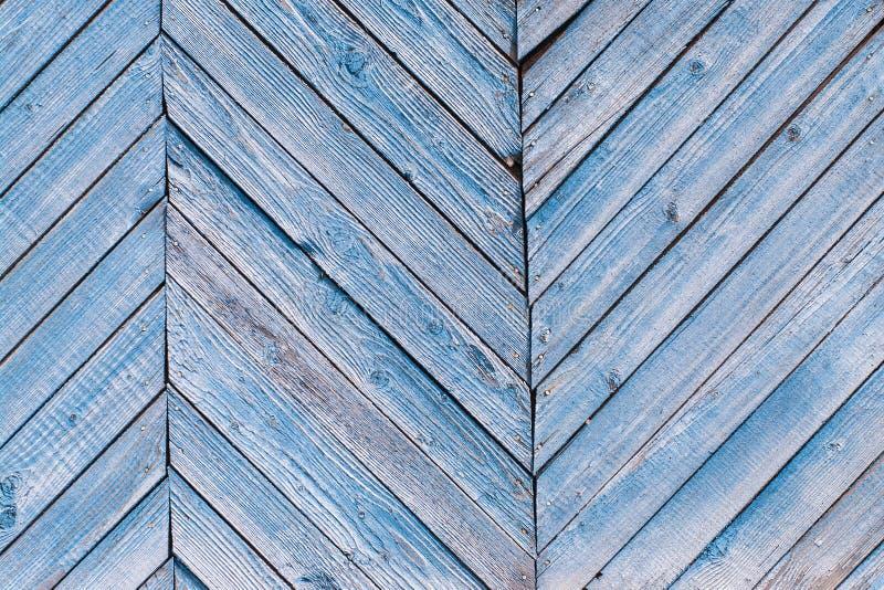 Starzeję się malował krakingowe deski z błękitnym koloru obieraniem Starego naturalnego grunge textured drewniany tło Wietrzejąca zdjęcia stock