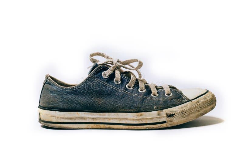 Starzy & brudni buty odizolowywający na białym tle obrazy stock