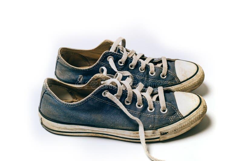 Starzy & brudni buty odizolowywający na białym tle zdjęcia royalty free
