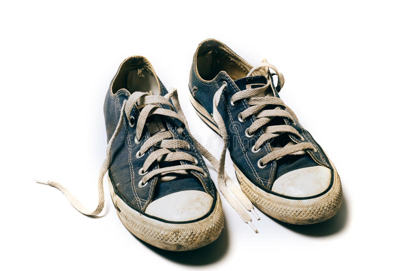 Starzy & brudni buty odizolowywający na białym tle fotografia royalty free