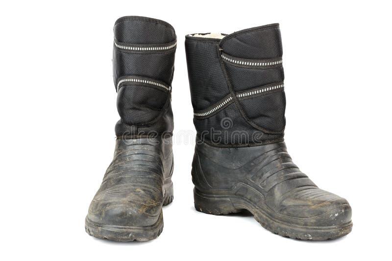 starzy gumowi mężczyzn buty wśrodku izolujący z futerkiem, fotografia stock