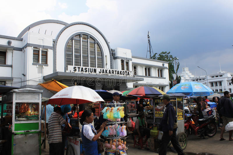 Stasiun kota old train station in Jakarta Indonesia dutch colonial building with street vendor in front stock images