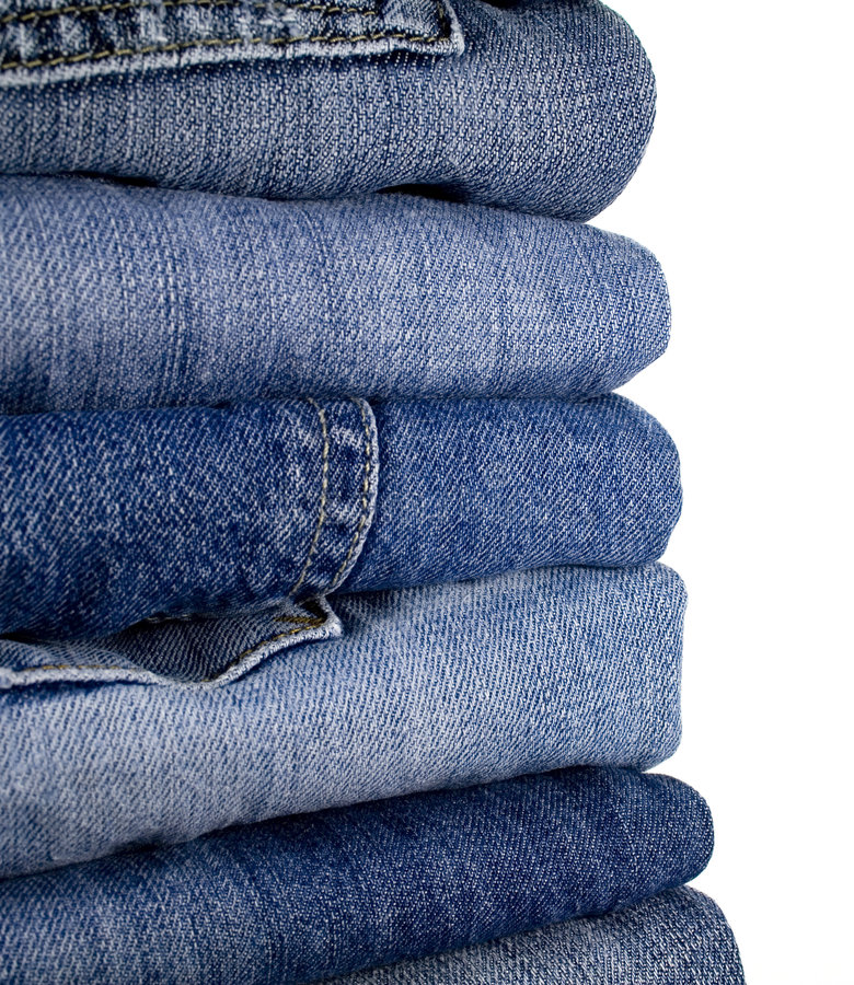 Stask of blue jeans royalty free stock images