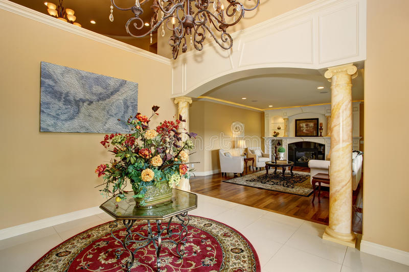 State of the art entance to luxury home with red rug. stock photo
