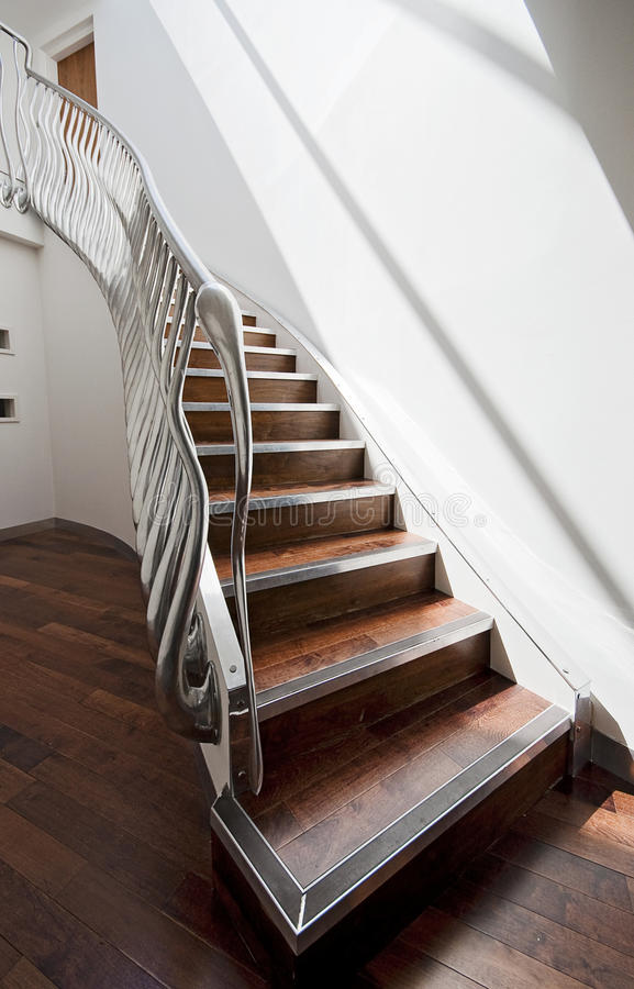 State of art staircase. State of art designer staircase with curly handrail stock photo