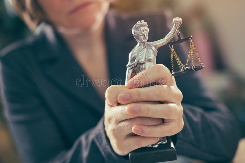 State attorney holding statue of Justice. In office, selective focus stock photography