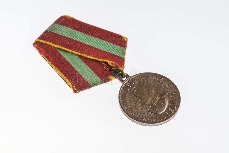 State Awards: Medal `For Valiant Labor in the Great Patriotic War 1941-1945`. An old grandfather`s medal award `For Valiant Labor in the Great Patriotic War 1941 royalty free stock image