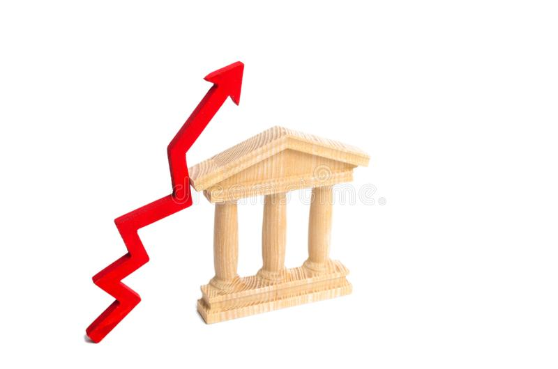 State building and red arrow up. The concept of improving the efficiency of the state, economic growth and prosperity. Distrust of. The government. Growth of stock photo