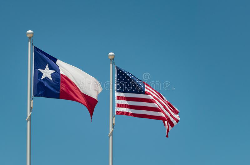 The state flag of Texas and American flag royalty free stock image