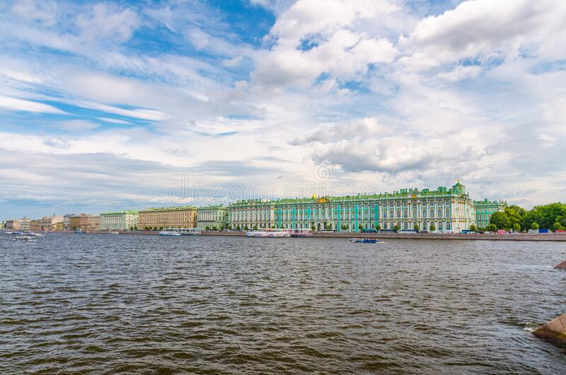 The State Hermitage Museum building, The Winter Palace official residence of the Russian Emperors. On embankment of Neva river, blue sky white clouds, Saint royalty free stock images