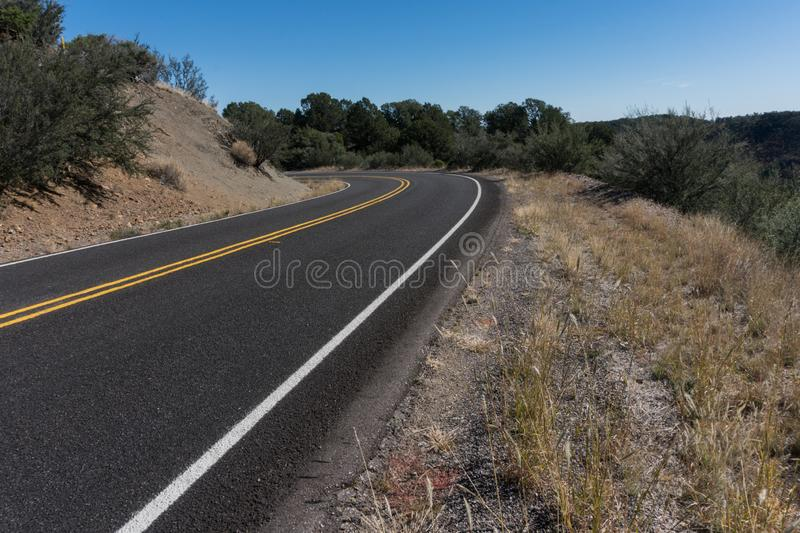 State highway 152 in southwest New Mexico. State highway 152 winds it`s way between Hillsboro and Silver city New Mexico. Damage from a past forest fire can royalty free stock photos
