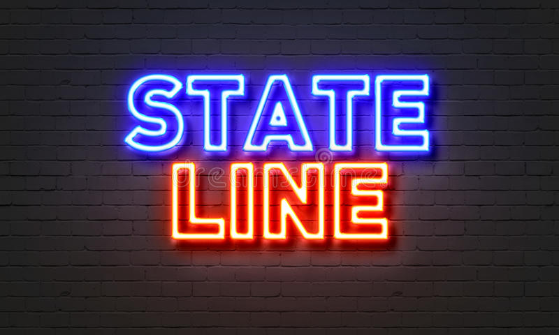 State line neon sign on brick wall background. stock image