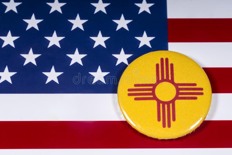 State of New Mexico in the USA. London, UK - November 15th 2018: The symbol of the state of New Mexico, pictured over the flag of the United States of America stock photo